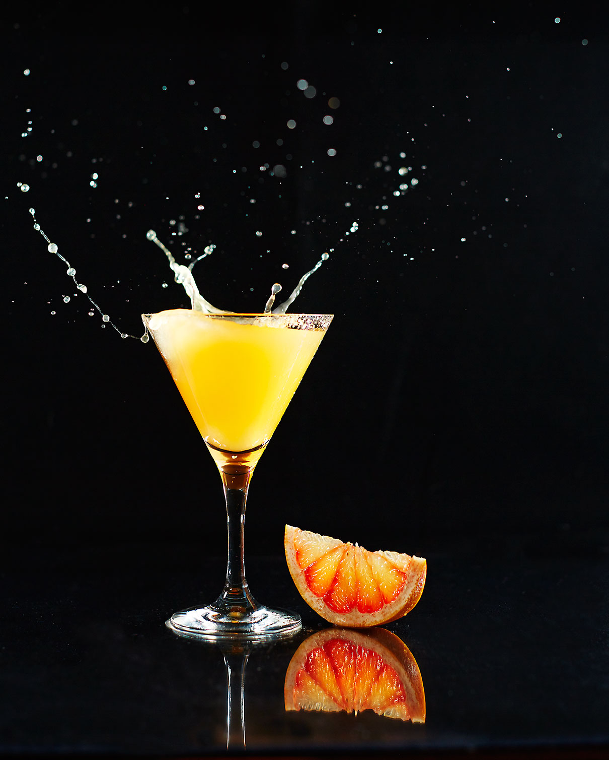 Splash of orange cocktail by Kelly Liken