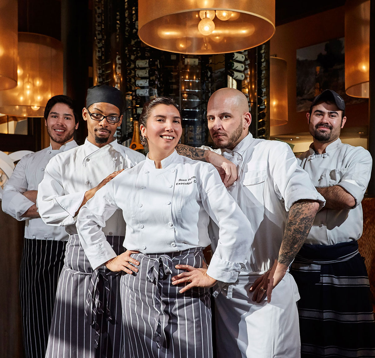 Woman Executive Chef and her crew