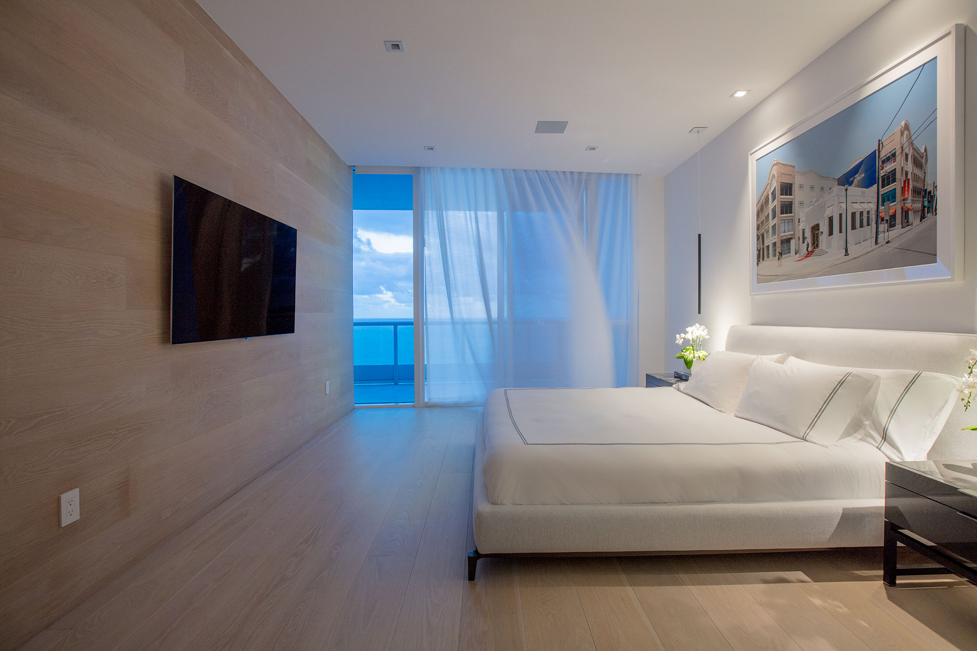 A warm breeze blows into a South Beach Florida Bedroom